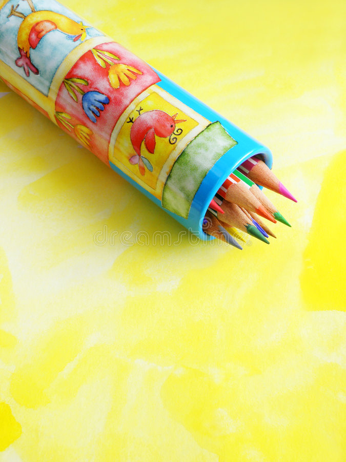 Back to school. Ready for start of school! - a concept image of a brightly colored metal cylinder box of bright coloring pencils. Decorated with cheerful happy stock images