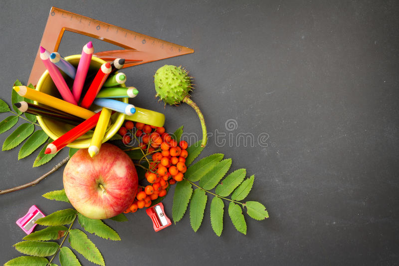 Back to school abstract background with crayons on blackboard stock photography
