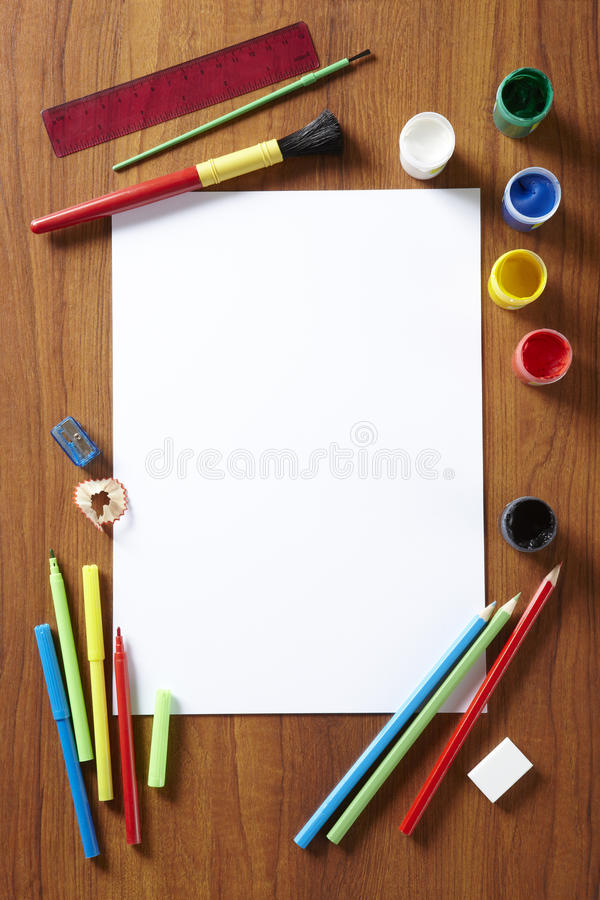 Back to School art pad paints pencils and pens. Back to School pupils art pad paints pencils and pens on wooden school desk from above stock photos