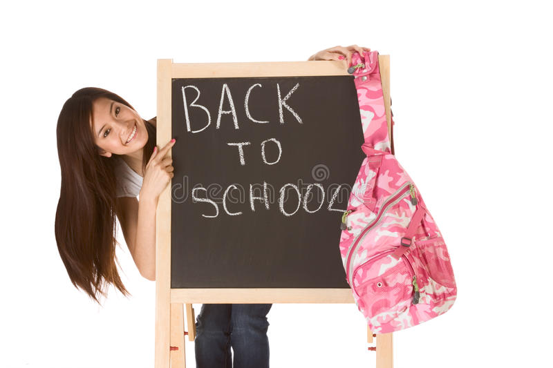Back to school Asian female student by blackboard stock photos