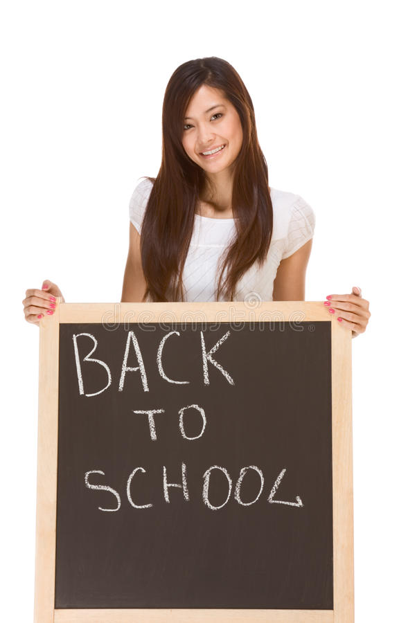 Back to school Asian female student by blackboard royalty free stock photo