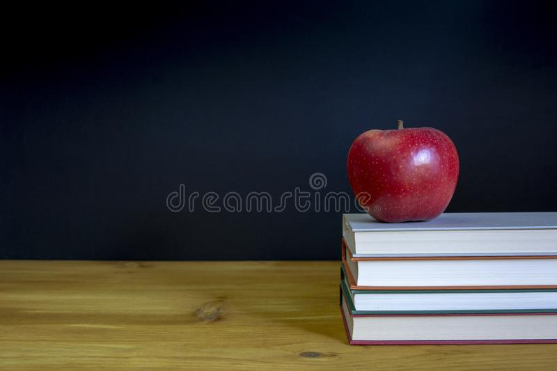 Back to school background with books over desk stock photos