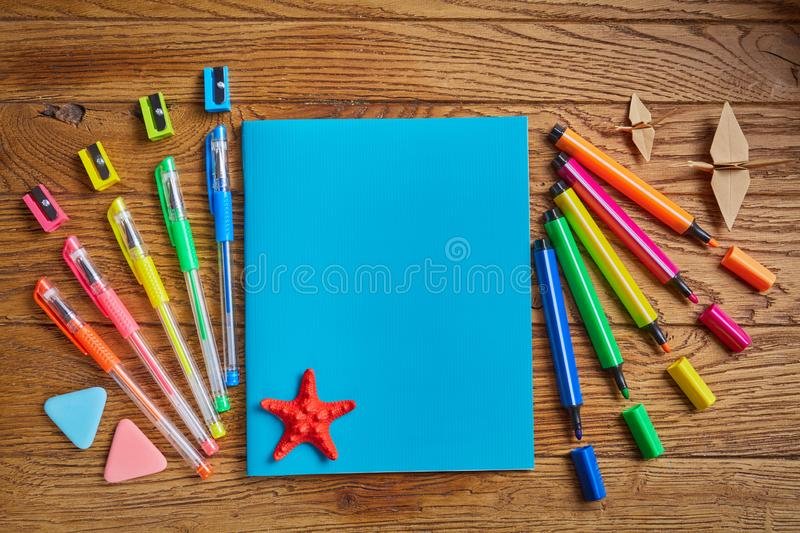 Back to school background. Back to School. Bright office supplies near a notebook with a star. on a wooden background. Top view, flat lay stock photography