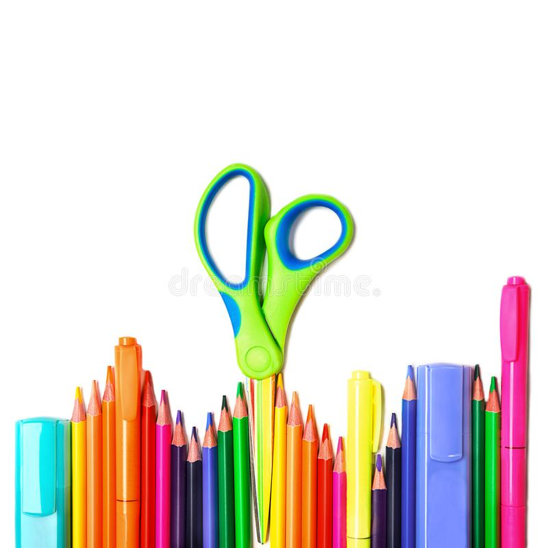 Back to school background with colorful pencils, scissors, markers on white backdrop, isolated. royalty free stock photo