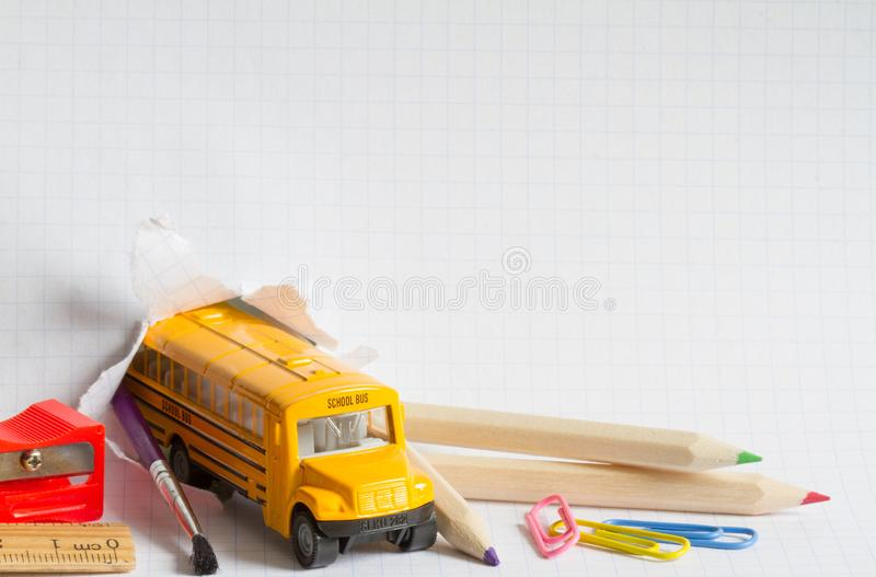 Back to school background concept with bus and accessories. Concept stock photos