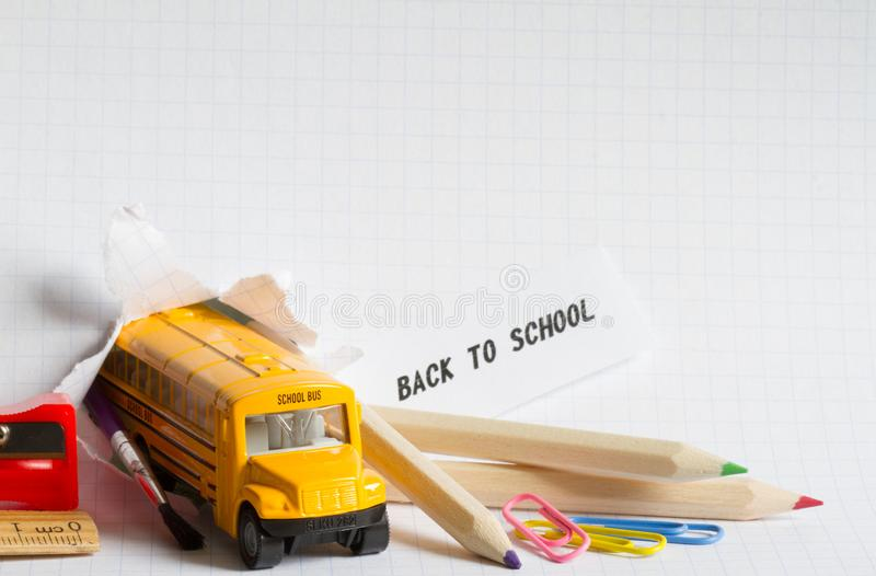 Back to school background concept with bus and accessories stock photo