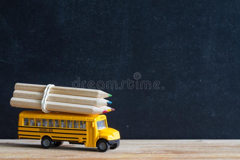 Back to school background concept with bus and accessories on blackboard stock image