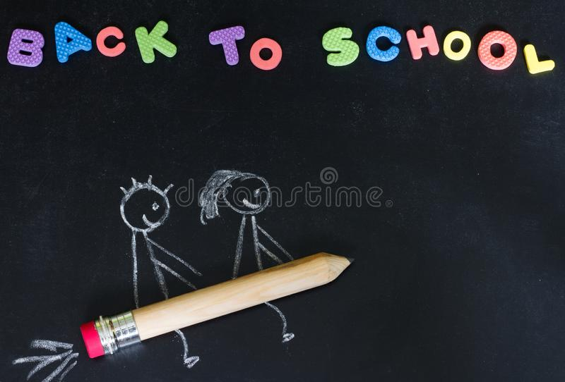 Back to school background concept with kids on the pencil rocket royalty free stock image