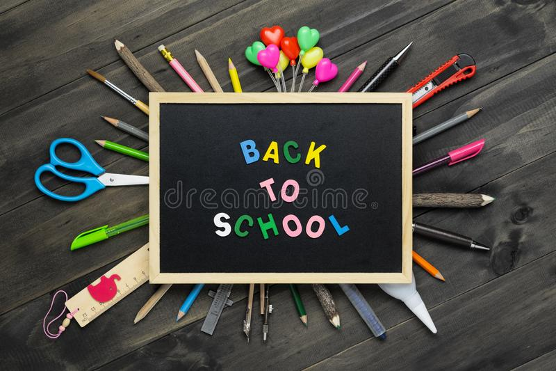 Back to school background concept. Back to Scool wood text arrange on blackboard on wood background with School supplies, station stock photos