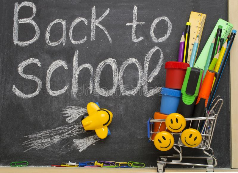 Back to school background with a flying airplane and stationery. stock image