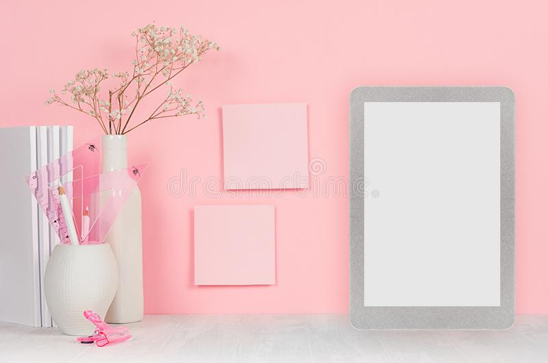 Back to school background for girl`s - white stationery, blank tablet computer and stickers on soft pink wall and white wood desk. Back to school background for royalty free stock photo