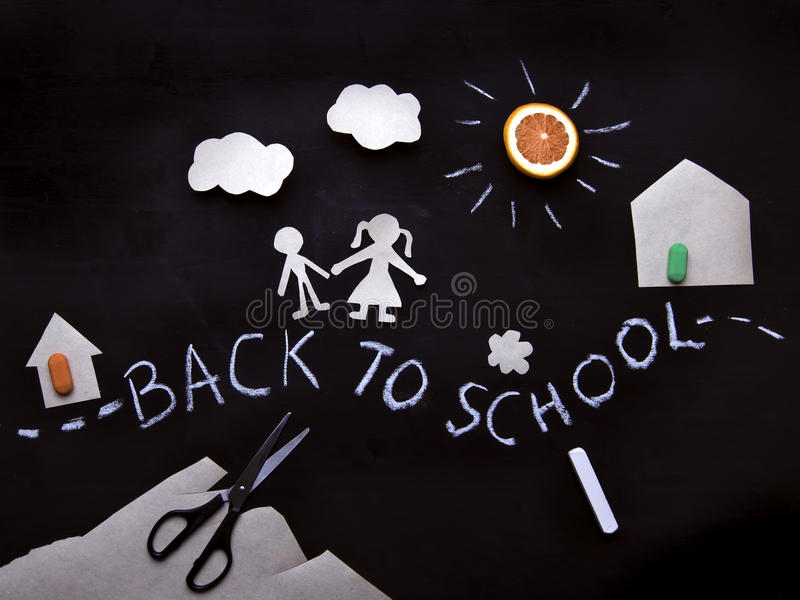 Back to school background with the kids going to school. Children`s creativity. Application on a blackboard. View from above stock images