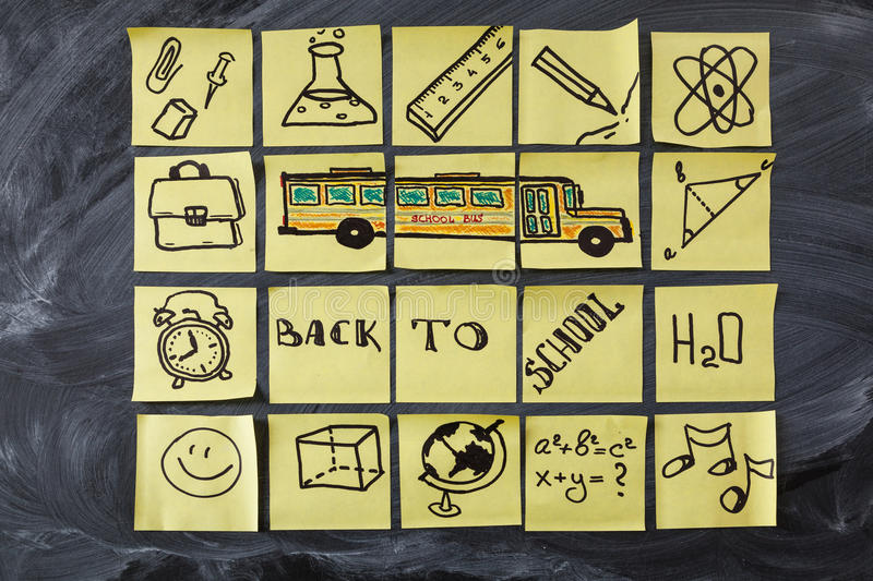 Back to school background with title Back to school, school bus and school attributes written on the pieces of paper. Back to school background with title Back royalty free stock photography