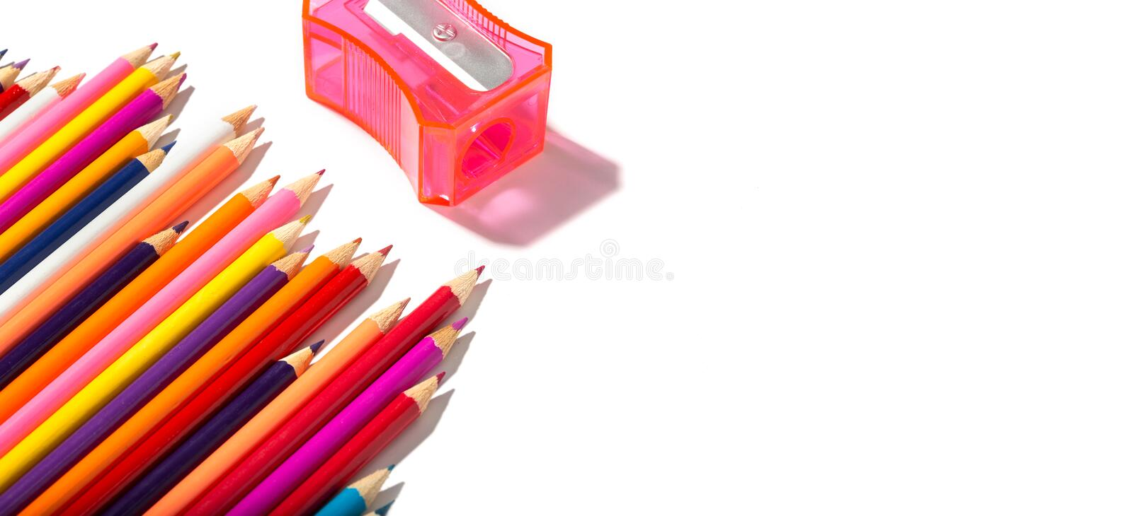 Back to school banner of multicolored pencils and pencil sharpener isolated on white background royalty free stock photos