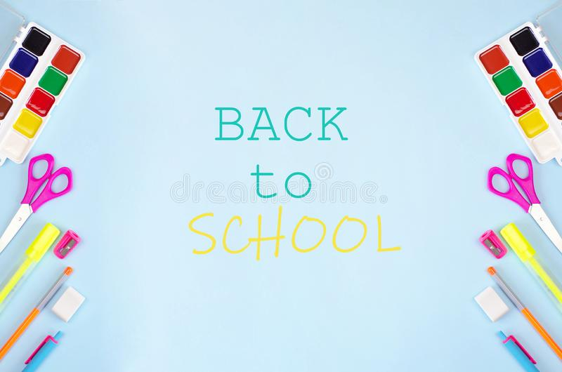 Back to school banner with stationery and blue background royalty free stock photography