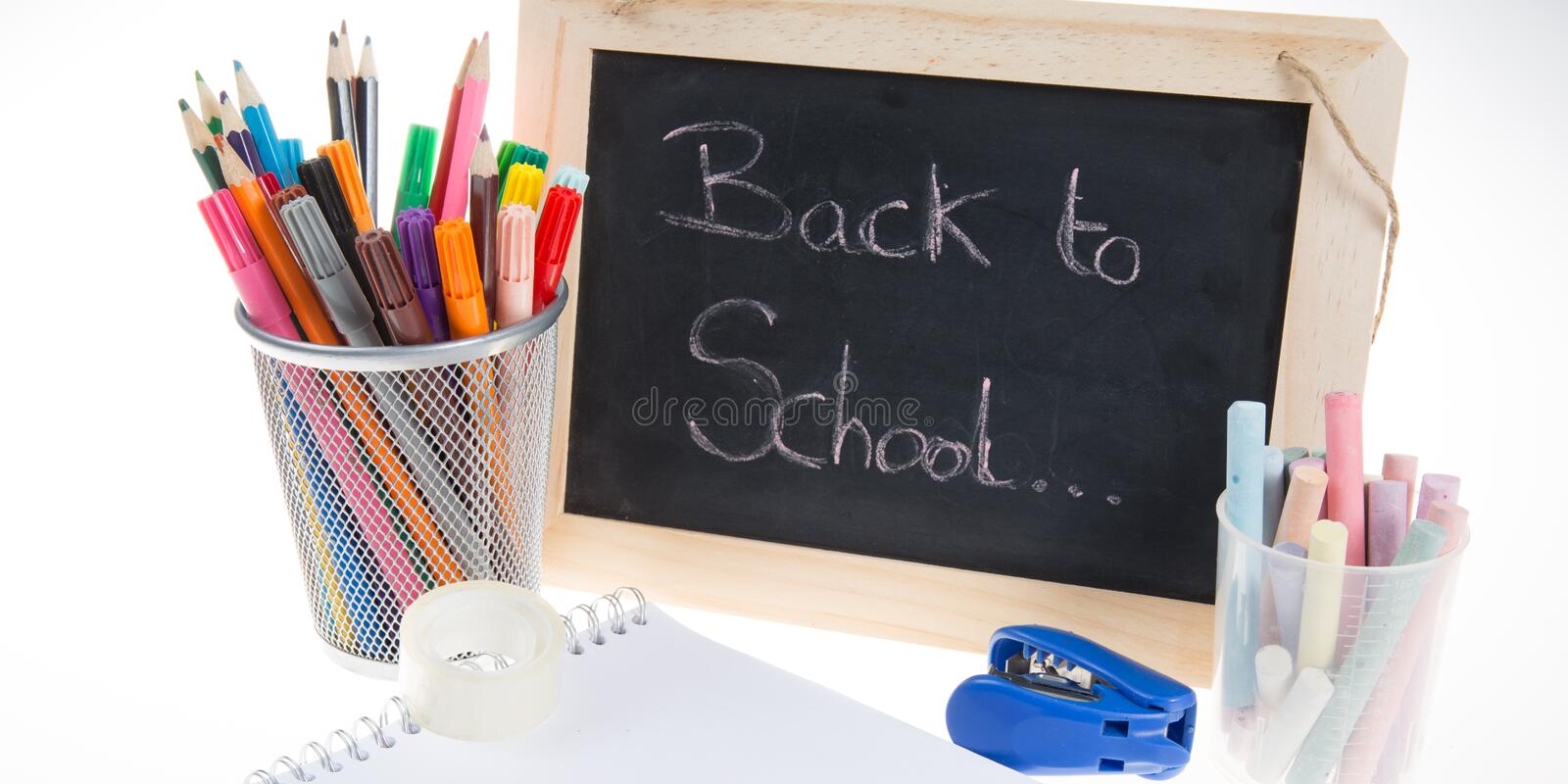 Blackboard and school supplies items and elements on the table stock photo