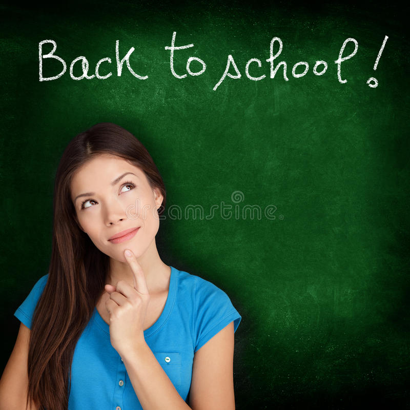 Back to school blackboard - woman student thinking stock photos