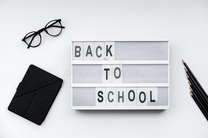 Back to School blocks with school supplies on white desk. Top vi stock images