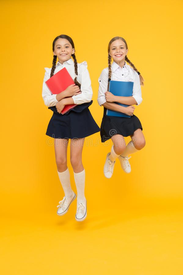 Back to school. Bring child school few days prior play playground and get comfortable. Cheerful school girls. Point out. Positive aspects starting school create stock photo