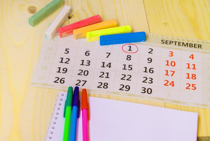 Back to school, calendar, colored chalk on wooden background. Dates, schedule, again, paper, education, memo, note, agenda, start, destination, text, white stock photos
