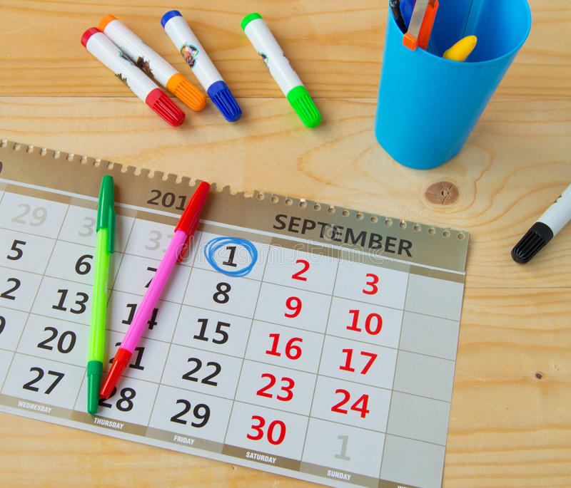 Back to school, calendar, colorful marker pens on wooden background royalty free stock photo