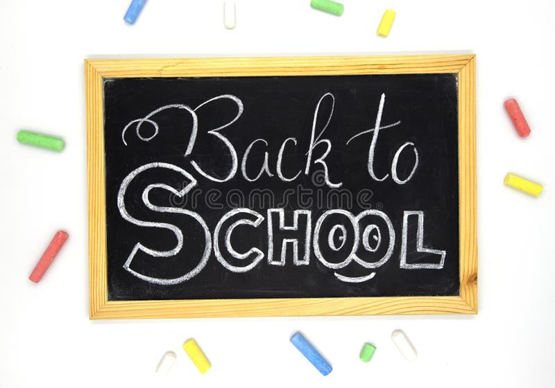 Back to school chalk lettering on blackboard with art supplies. School banner template. School supplies composition. royalty free stock images