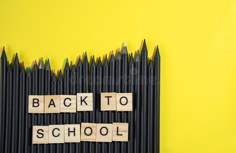 Back to school collected from wooden elements letter block on bu stock images