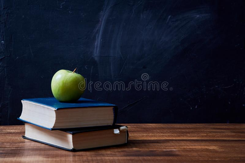Back to school, college or student and education concept. Books, apple and accessories for school royalty free stock photo
