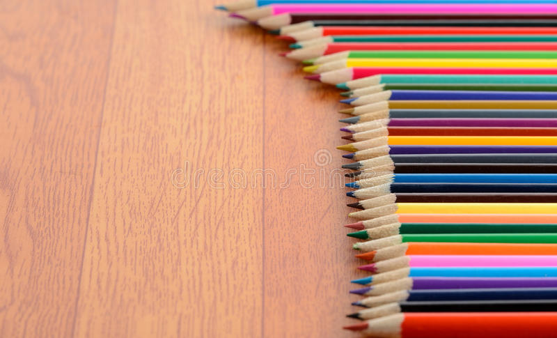 Color Pencils on Wood Floor royalty free stock images