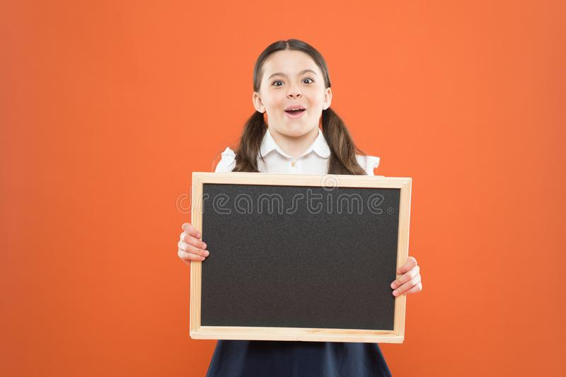 Back to school. commercial marketing conept. business advert. new shopping idea. school market sales. signage. cheerful. School girl with blackboard. happy royalty free stock photography