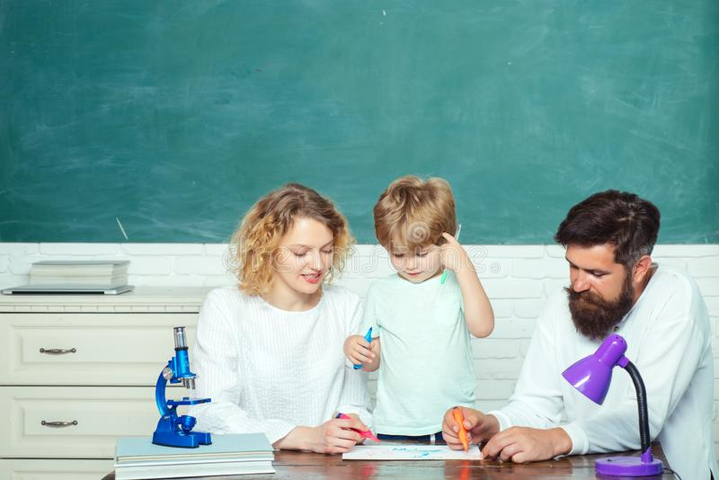 Back to school. School community partnership models. Cute pupil and his father and mother making schooling work. Happy stock photos