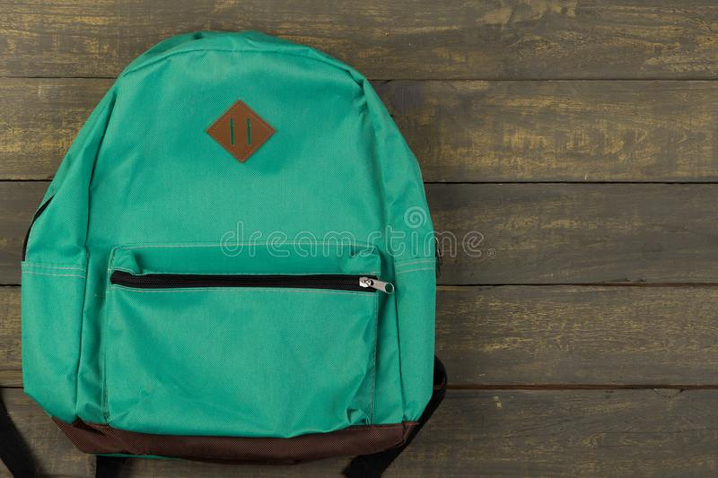 Back to school concept - blue backpack on wooden backgroung royalty free stock image