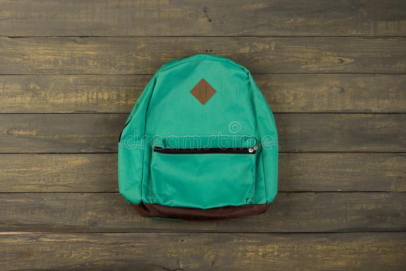 Back to school concept - blue backpack on wooden backgroung royalty free stock photo