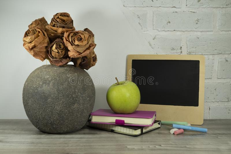 Back to school concept with books and green apple royalty free stock photo