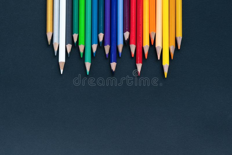 Back to school Concept. Close up shot of color pencil pile pencil nibs on black background with copy space royalty free stock photography