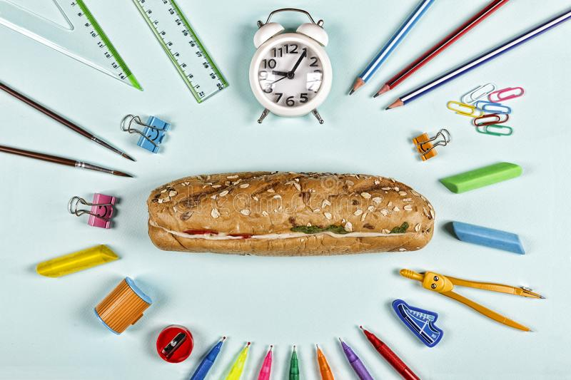 Back to school concept. education, school snack, school supplies, student, college, flatlay, eating outdoor stock image