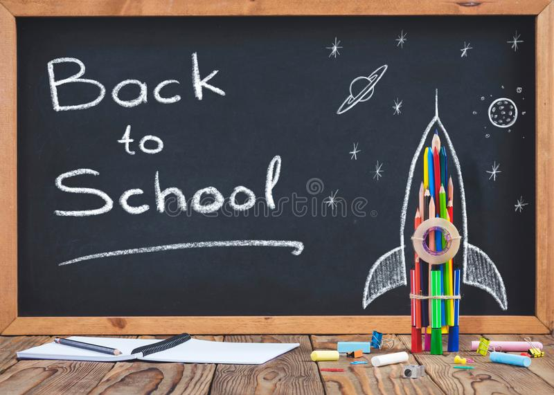 Back to School Concept with Hand Drawn Rocket. On Blackboard royalty free stock photography