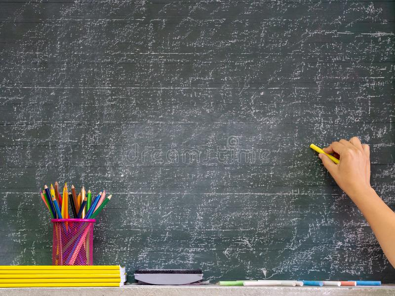 Back to school concept. Hand writing on the blackboard with stat royalty free stock photo