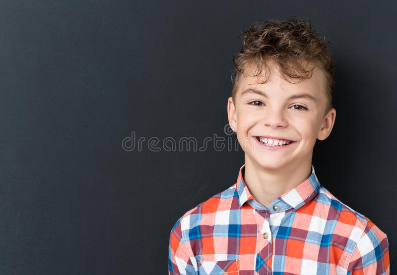 Back to school concept - happy boy looking at camera royalty free stock image