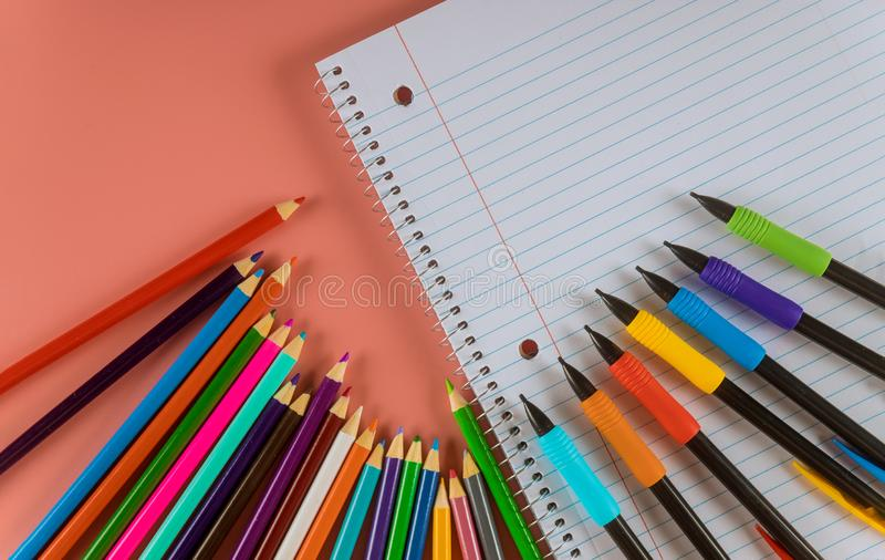 Back to school concept school office supplies on a with copy space of papers, pencils, markers and notepads. Back to school concept school office supplies of royalty free stock images