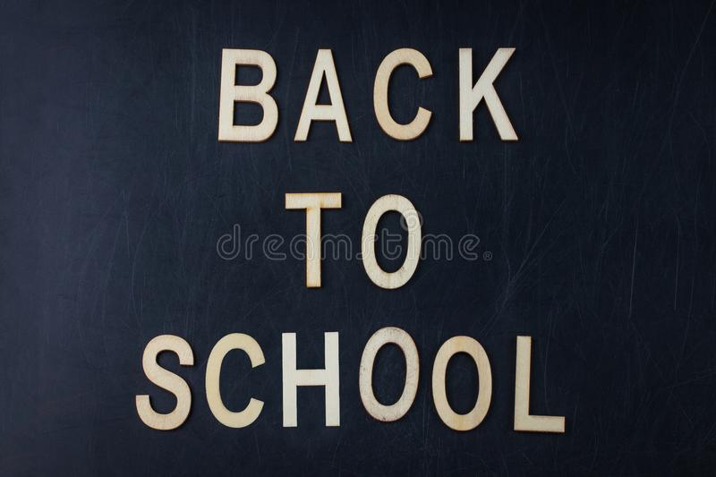 Back to school concept over classroom blackboard background royalty free stock photography
