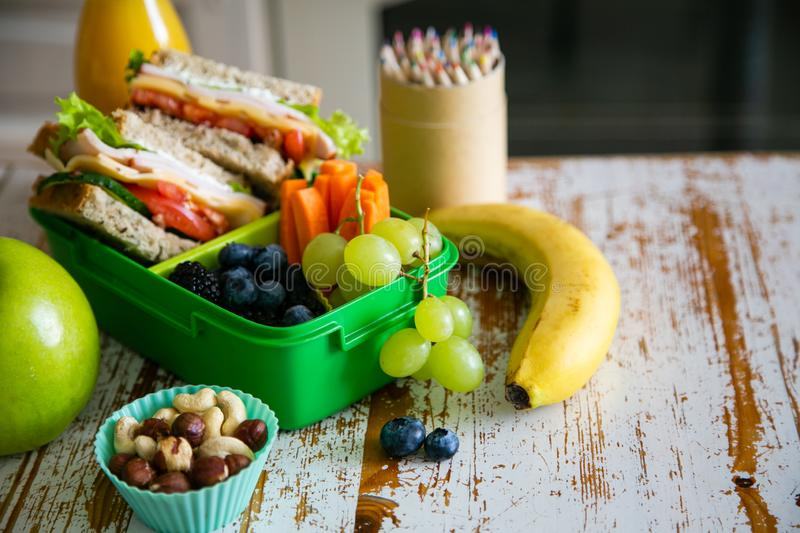 Back to school concept - packed school lunch on kitchen background stock image