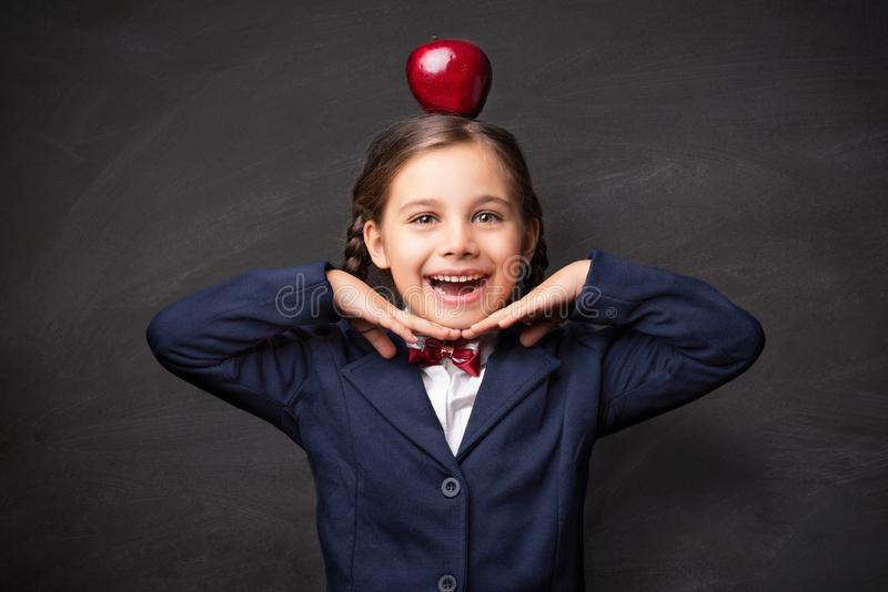 Back To School Concept, Portrait of Happy Smiling Child Student with Apple stock images