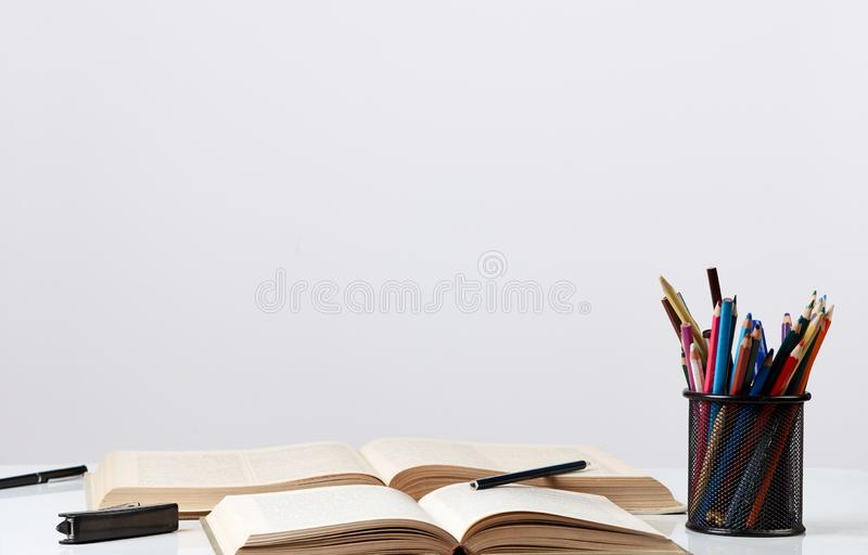 Back to school concept with school supplies on a desk , close-up royalty free stock photos