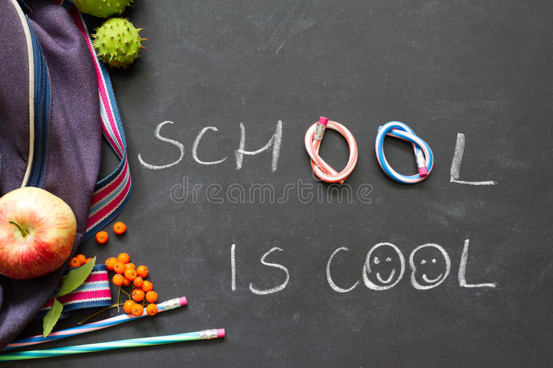 Back to school concept witch chalkboard and supplies royalty free stock images