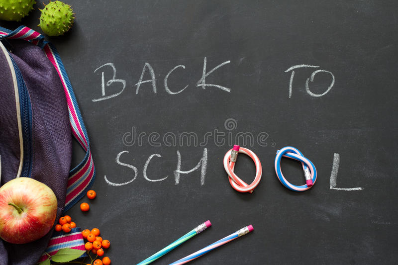 Back to school concept witch chalkboard and supplies stock photography