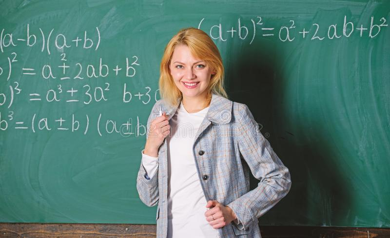 Back to school concept. Woman smiling educator classroom chalkboard background. Working conditions which prospective. Teachers must consider. Educator stock photography