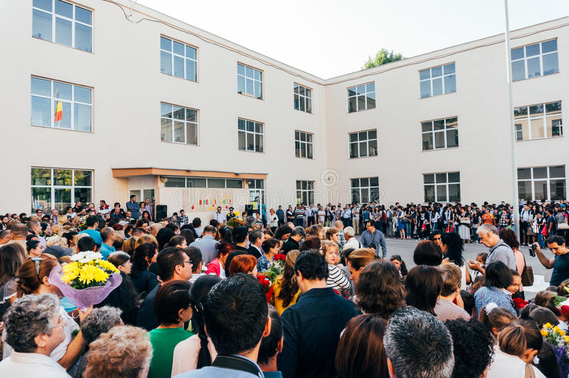 Back to school. Crowd of students and parents back to school at the opening ceremony stock photography