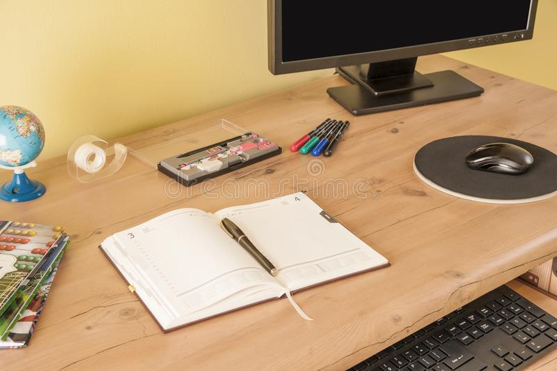 Desk with equipment for school and the calendar for better planning time. Back to school / desk with equipment for school and the calendar for better planning stock images