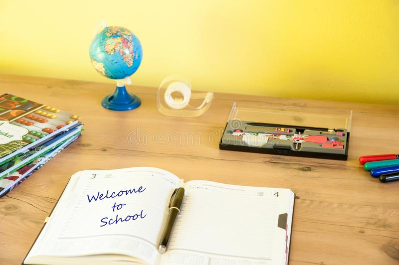 Desk with equipment for school and the calendar for better planning time. Back to school / desk with equipment for school and the calendar for better planning royalty free stock photos